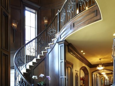 Wooden staircase and hallway Wooden in house designed by Custom Home Builder Sam Vercher