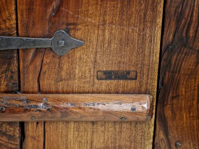 Wooden door detail of a luxury home designed by Sam Vercher
