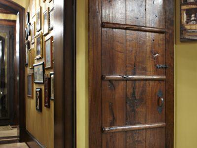 Wooden doors in hallway of the house designed by Custom Home Builder Sam Vercher